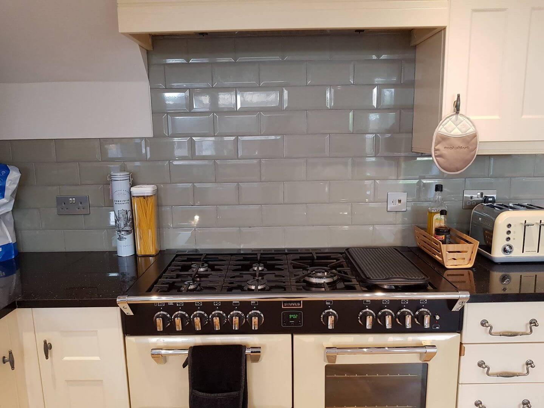 Green kitchen splashback tiles in a cream country kitchen