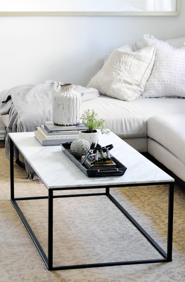 white styled coffee table with plant and books