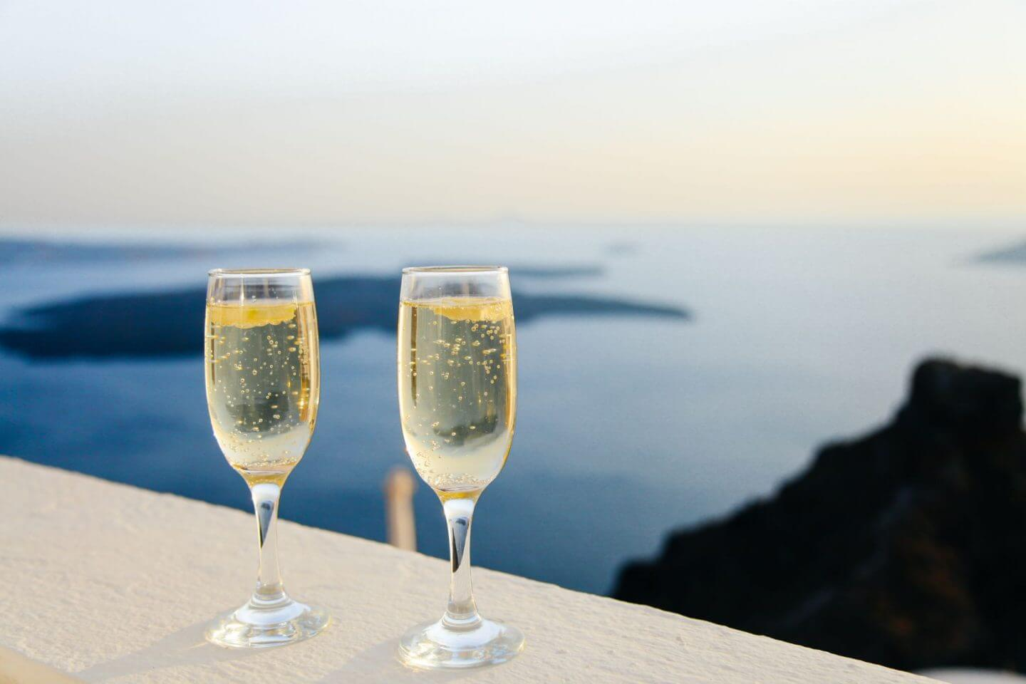 champagne glasses on honeymoon in Greece