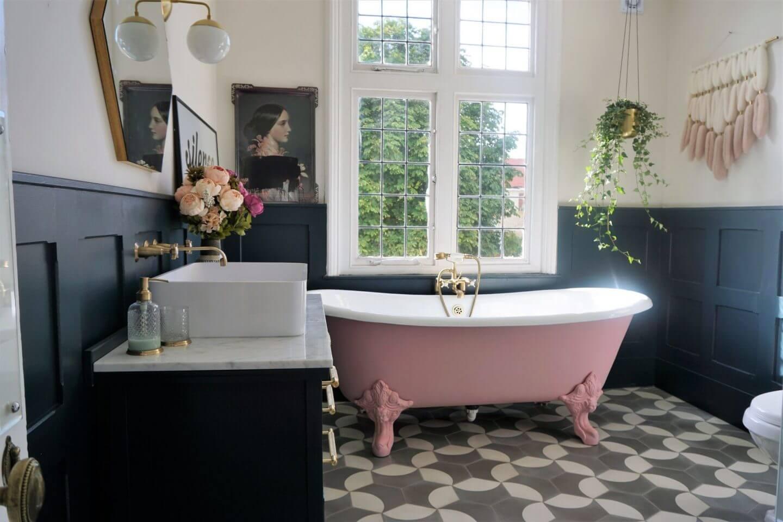 Pink bathtub in bathroom