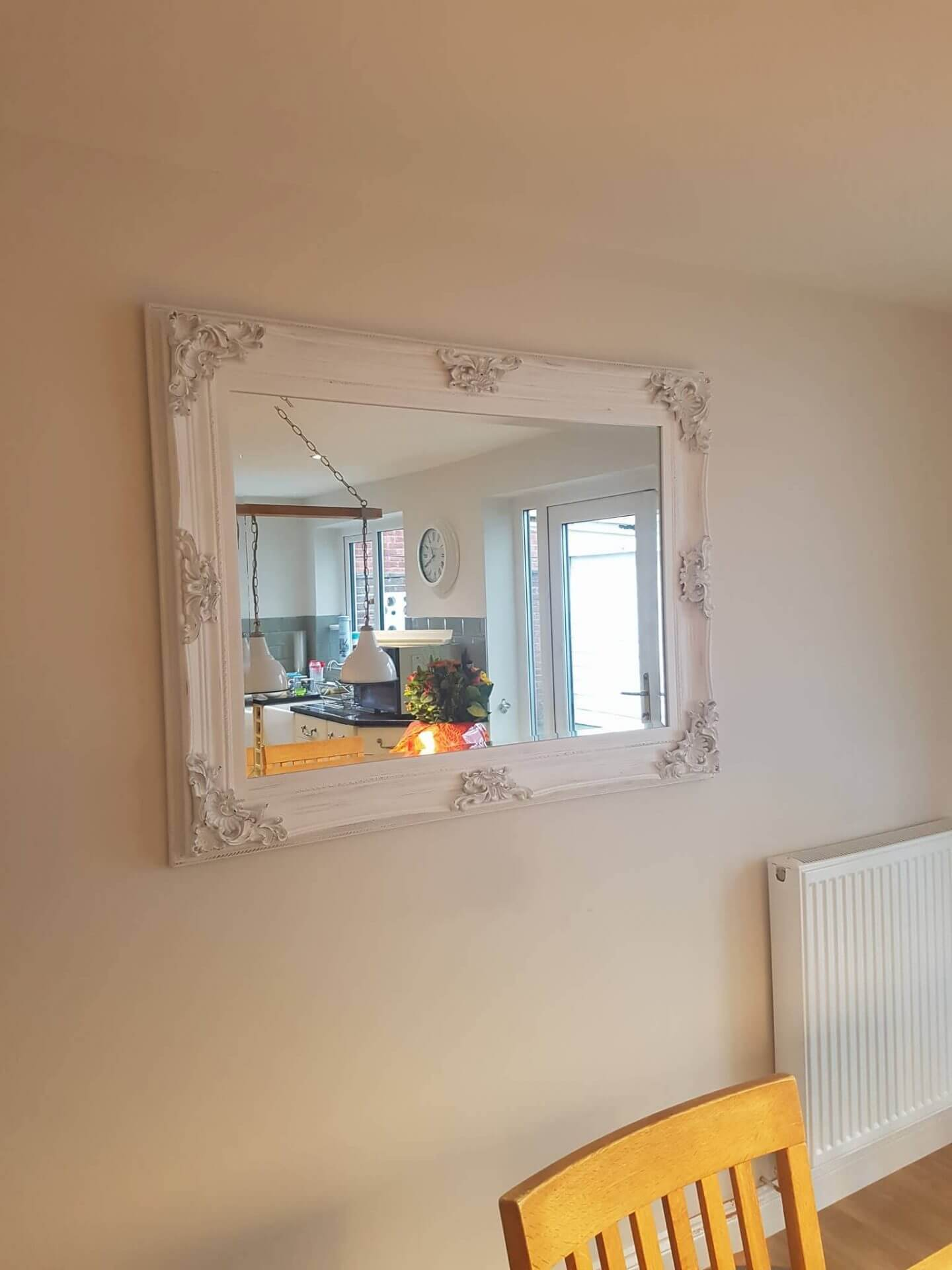 white distressed mirror on a wall