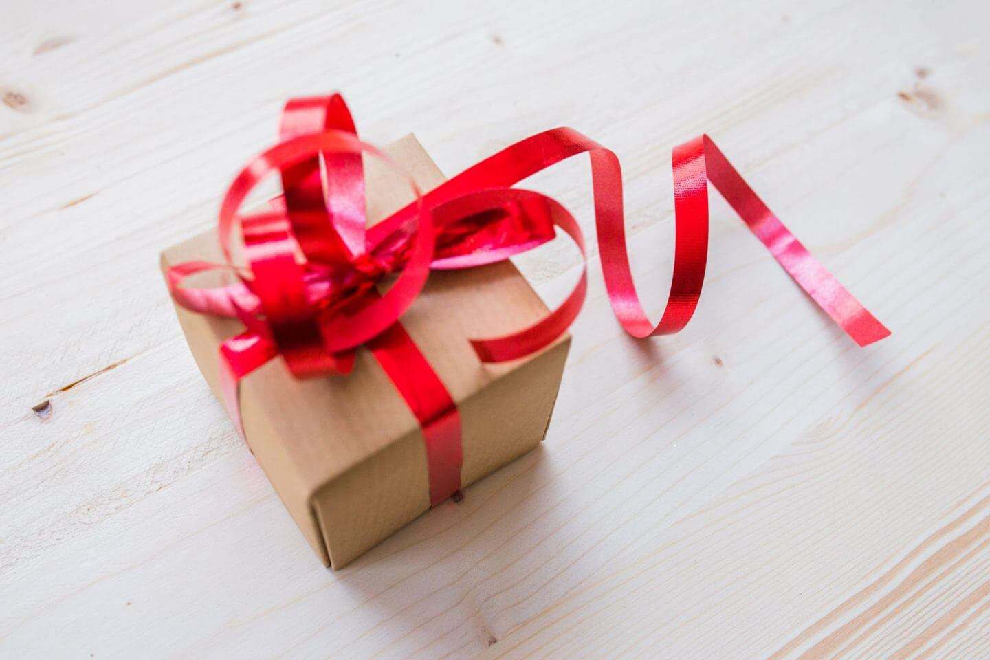 present in brown paper with red bow