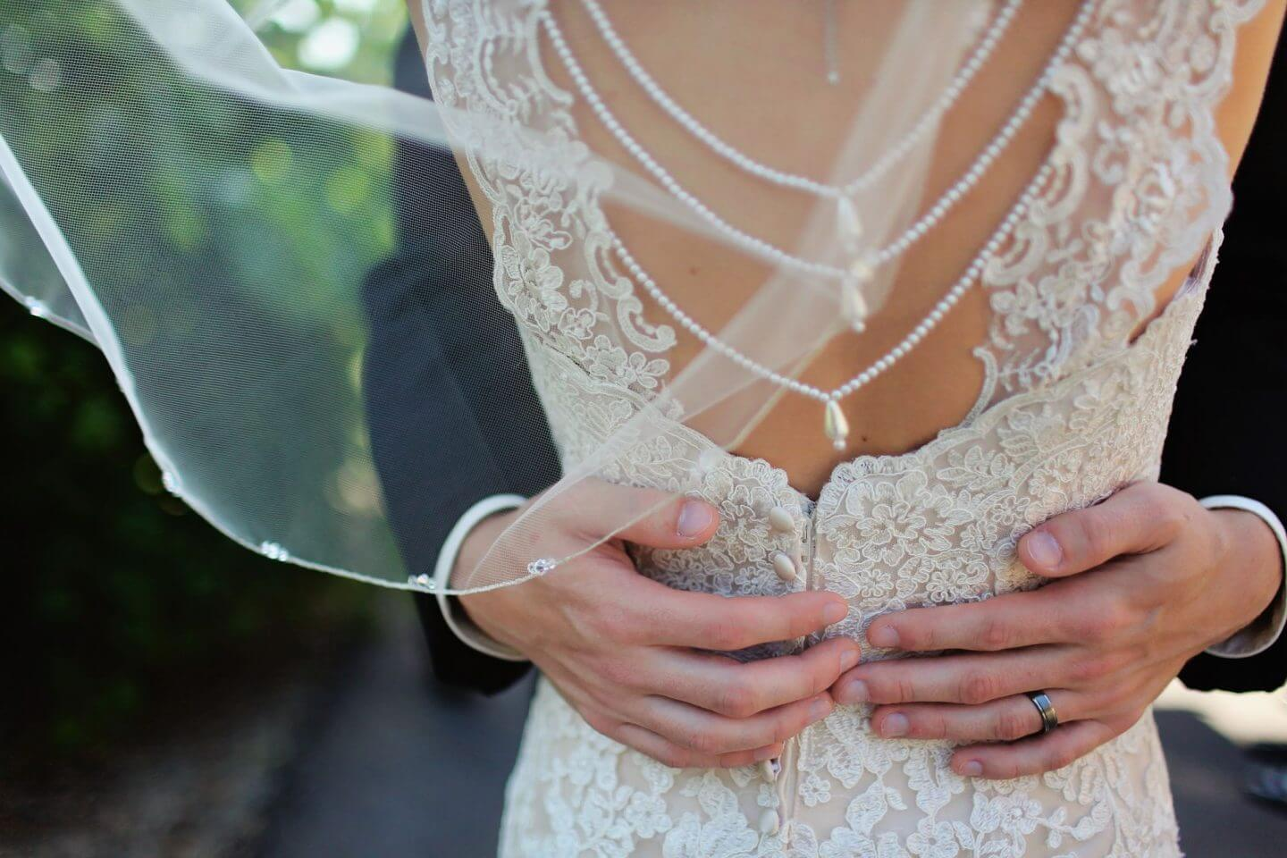 back of wedding dress with wedding ring