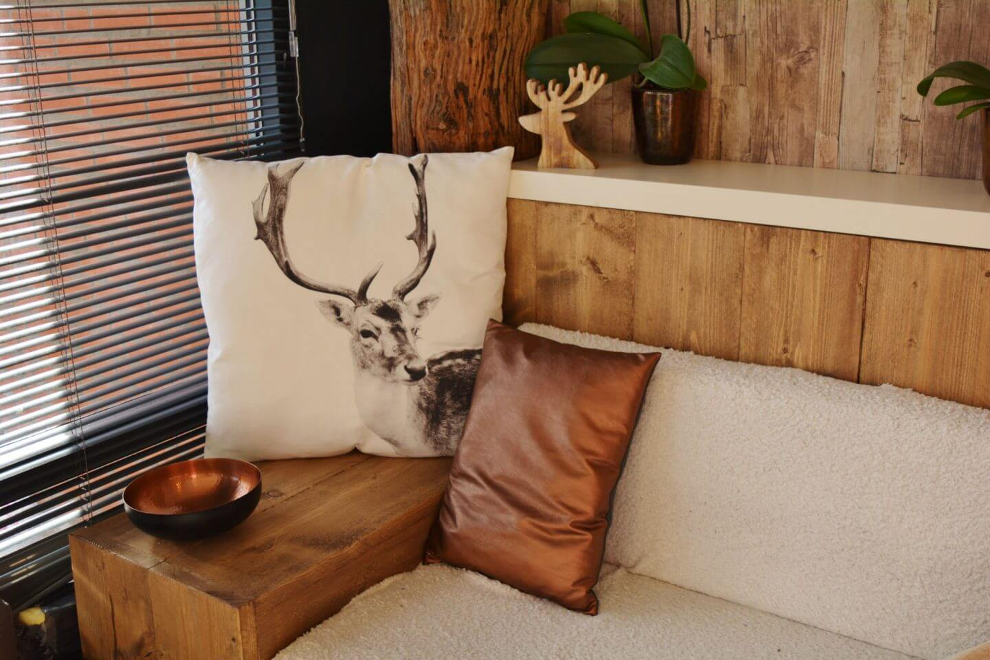 cushion with stag on it on bed