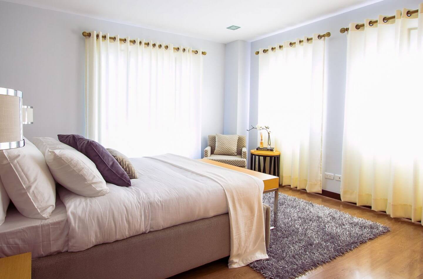 light room with large bed and yellow and purple colours