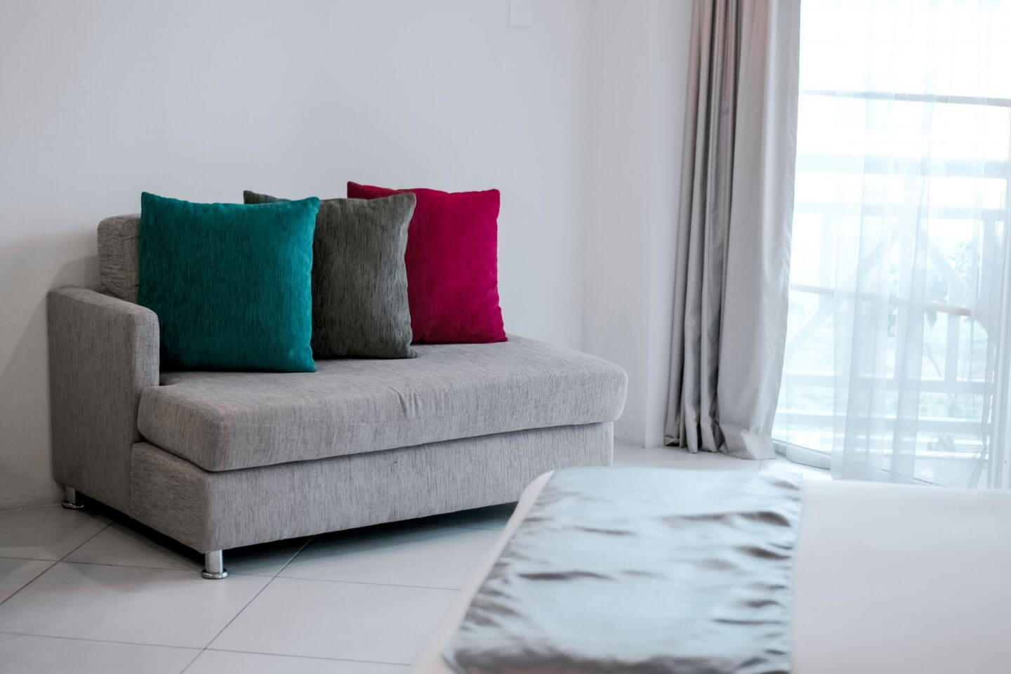 Grey sofa with bright coloured cushions