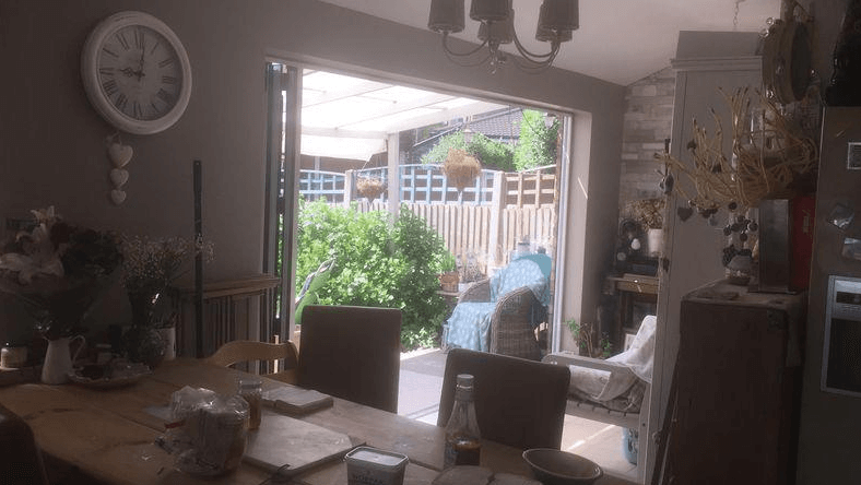 Terrible photo of dining room opening out into the garden