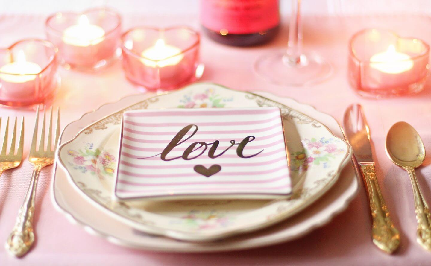pink and gold themed table with stripy plates