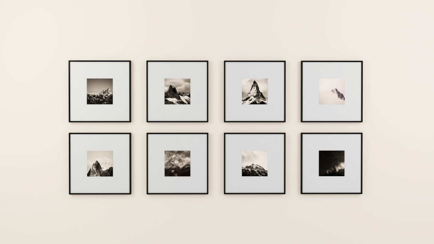 Sell your home faster by adding simple artwork. Black and white photos of mountains in frames.