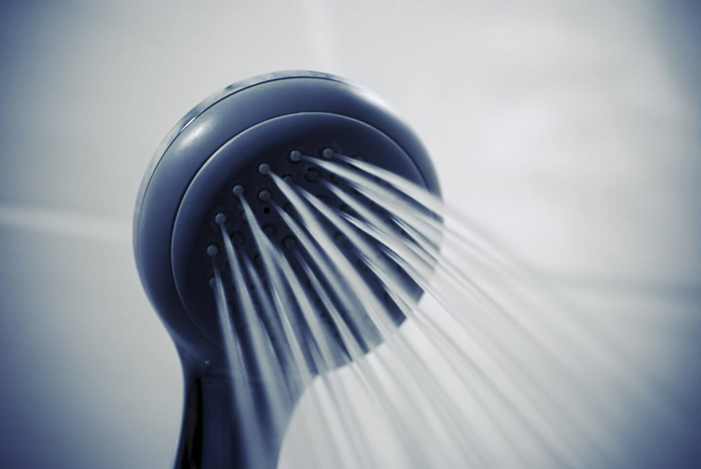 Redecorate your bathroom in January because you can use the gym showers instead. Picture of a shower head with water coming out.
