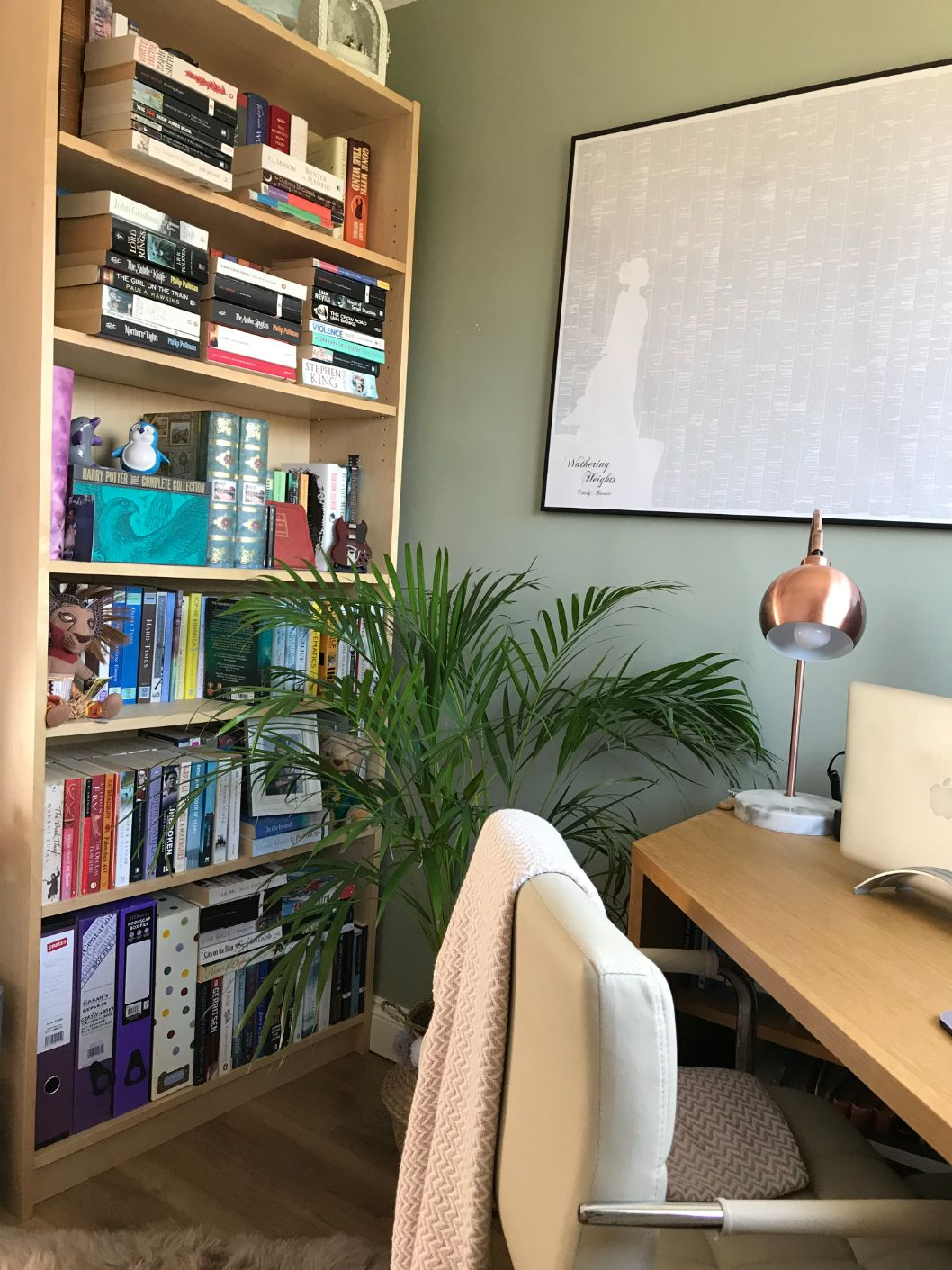 Home office with palm plant and bookcase