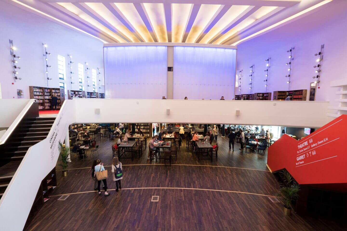 Inside of Storyhouse: view of the main foyer with the bar/cafe and part of the library