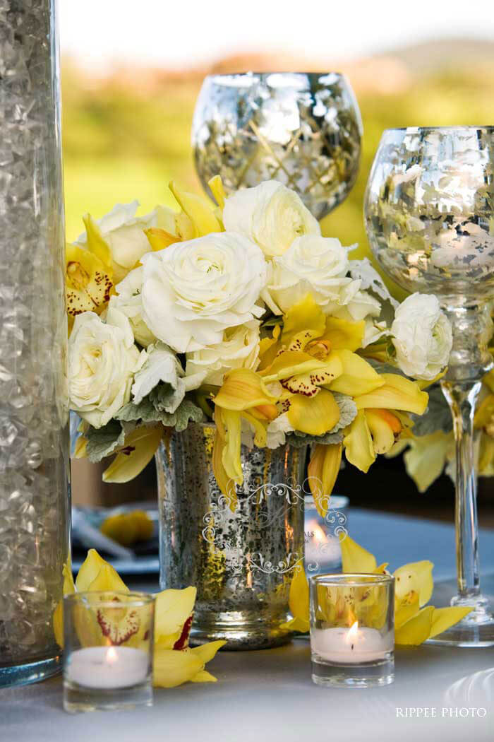 yellow and grey wedding theme - yellow flowers and white roses on grey tablecloth