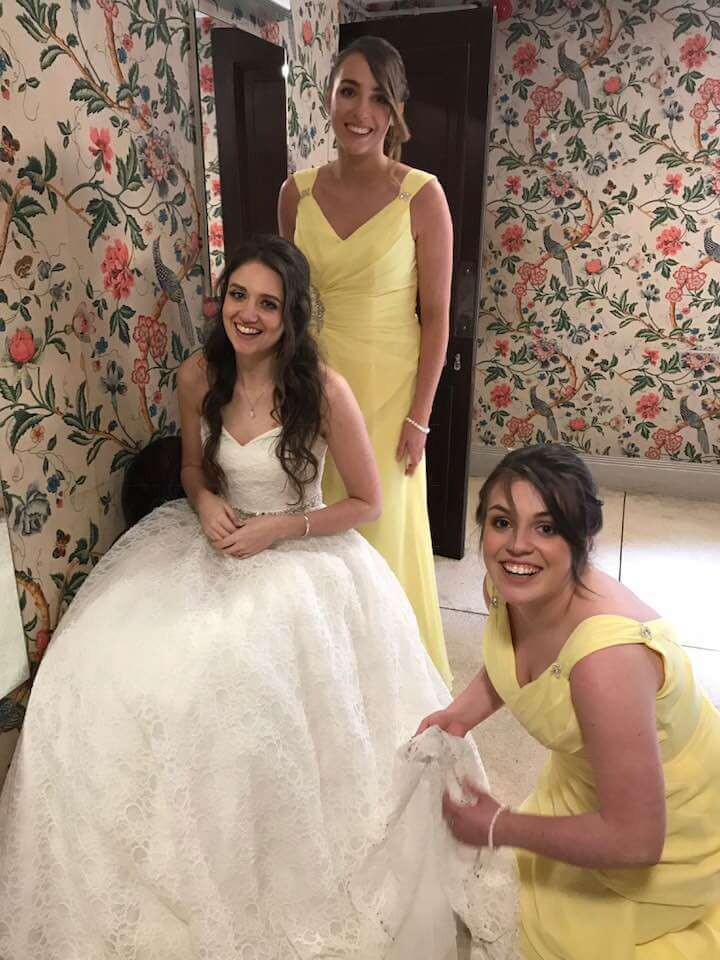 Wedding dress with bridesmaids in yellow bridesmaid dresses