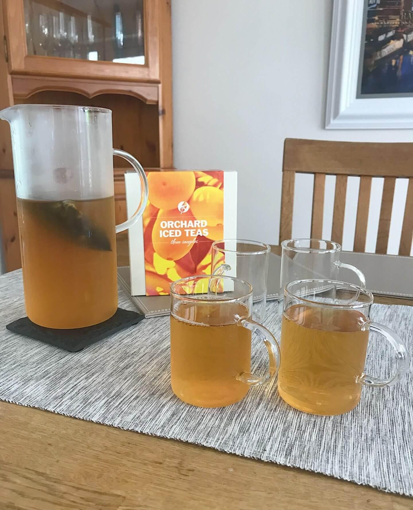 Adagio peach tea with large jug and tea glasses