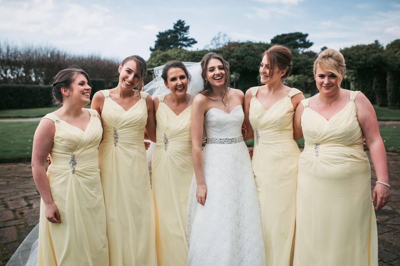Bridesmaids in Yellow Aristocrat dresses. Kimberly yellow