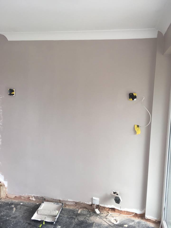 Painted wall with no skirting boards or flooring
