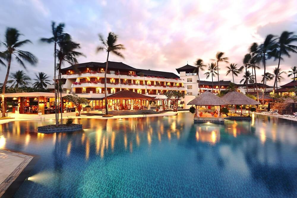 Bali hotel and spa resort with large pool and palm trees