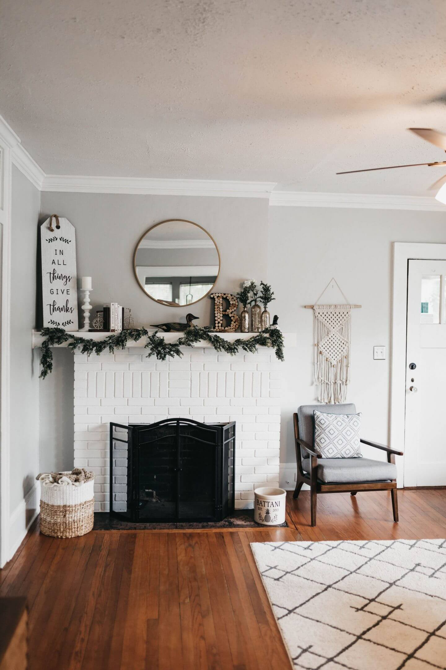Christmas fireplace with garland along the mantel