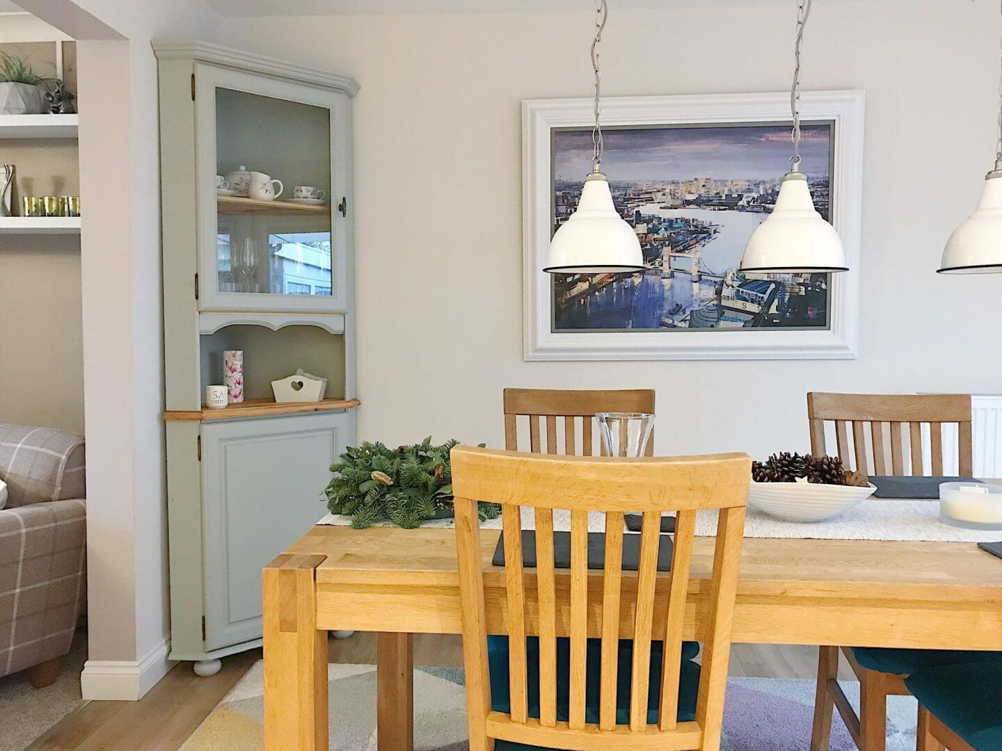 Dining room with artwork on the wall to help sell your home faster